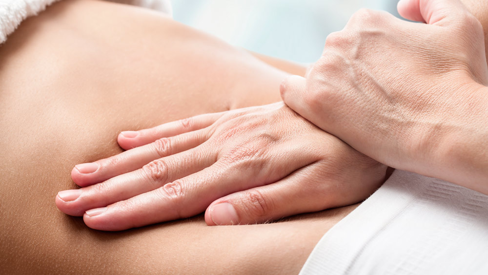 bigstock-Osteopathic-Belly-Massage--101642327